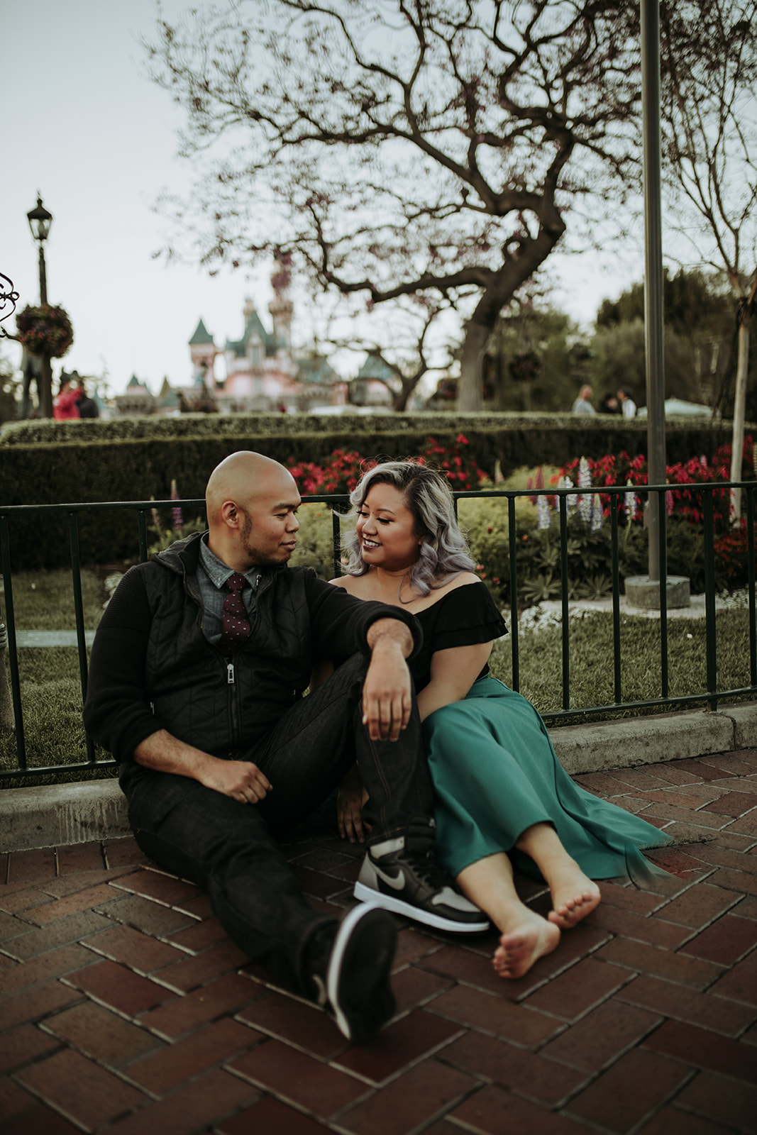 After hours of walking around Disneyland and California Adventure, we needed a break and found a nice little patch of brick to sit on.