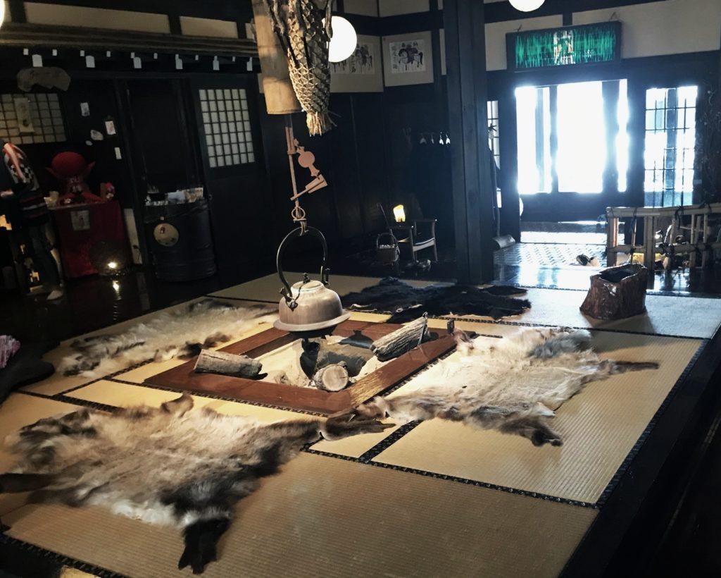 Kakurean Hidaji ryokan in takayama japan, japanese interior with tatami mats, fur rugs and hanging kettle